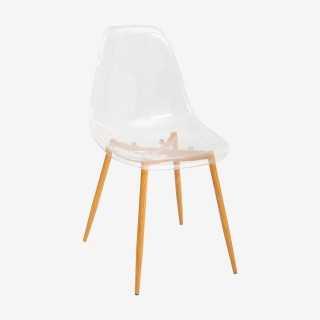 Vue de trois-quarts de la chaise MAHO transparente